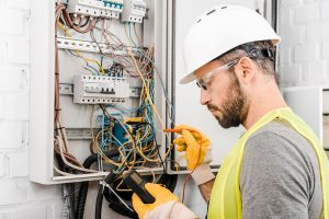 electrician checking the electrical panel