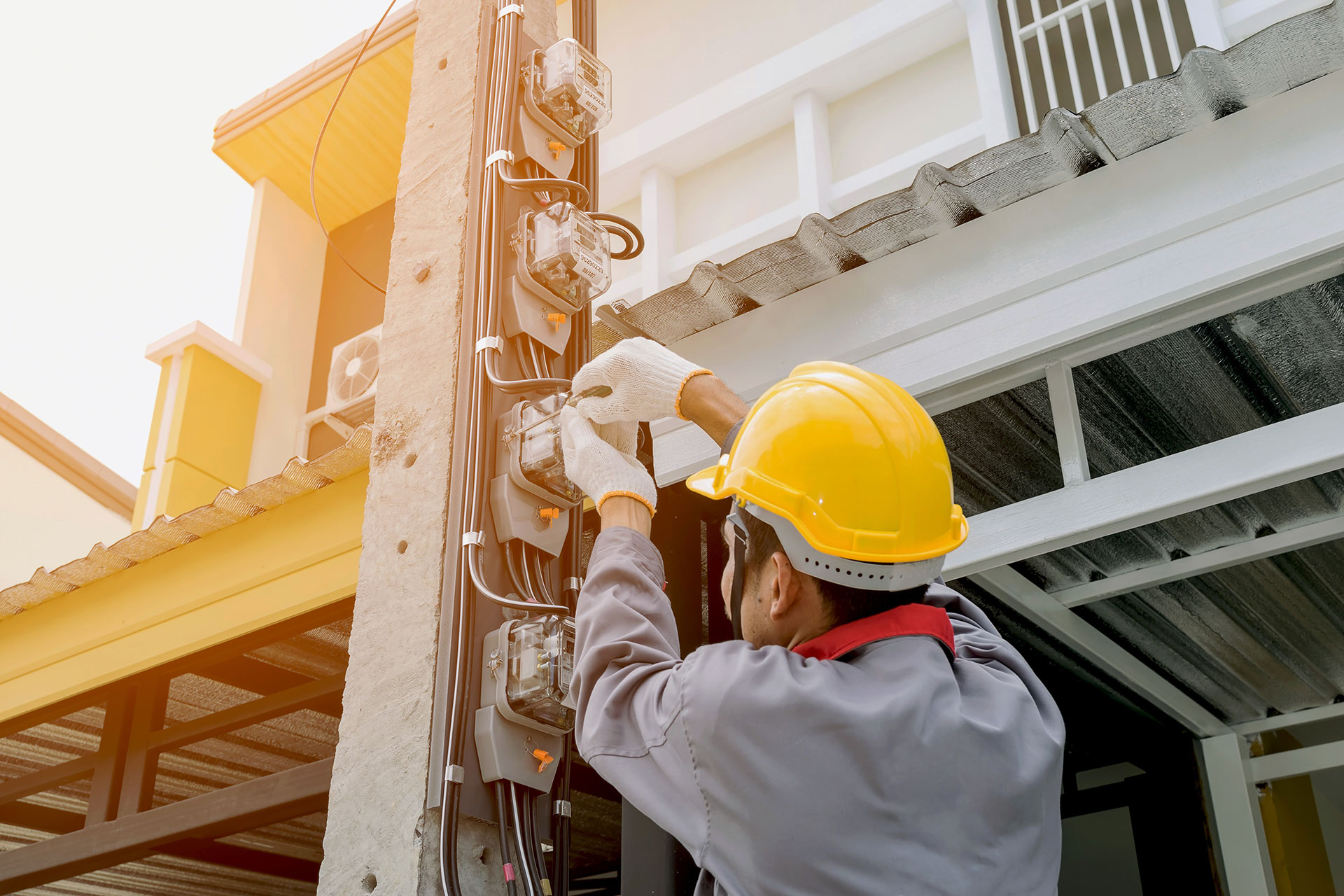 electrician working on electric post