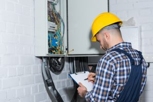 domestic electrician inspecting